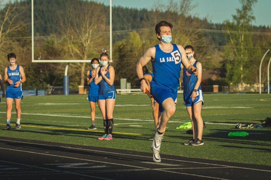 """This season is Nathan Henry's first year participating in high jump for track and field, and he had just two days of practice before the first meet. Henry's mentality going into this meet was that """"I'm just going to have fun, and if I do good, that'll be great,"""