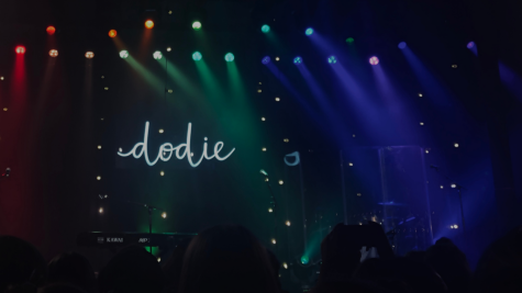 """An hour before I was lucky enough to hear Dodie live in a concert, colorful pieces of paper were passed down the excitedly chattering line by a couple of fans. During """"Rainbow,"""" we placed the papers on our phones and turned on our flashlights to create a rainbow of lights in the audience to match the lights on stage."""