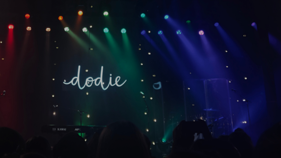An+hour+before+I+was+lucky+enough+to+hear+Dodie+live+in+a+concert%2C+colorful+pieces+of+paper+were+passed+down+the+excitedly+chattering+line+by+a+couple+of+fans.+During+%E2%80%9CRainbow%2C%E2%80%9D+we+placed+the+papers+on+our+phones+and+turned+on+our+flashlights+to+create+a+rainbow+of+lights+in+the+audience+to+match+the+lights+on+stage.