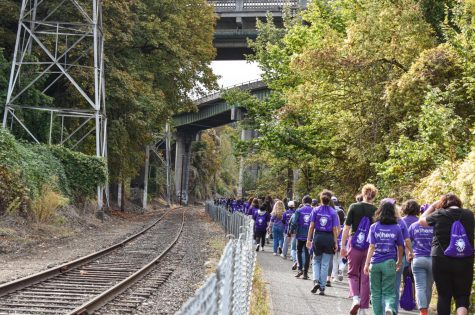 Following the curve and route of the railroad track and chainlink fence, the cavalcade of students proceeded along the Springwater Corridor Trail.