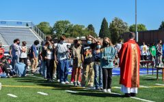 The mass on Tuesday, Sept. 14, concluded with a mutual blessing between staff and students.